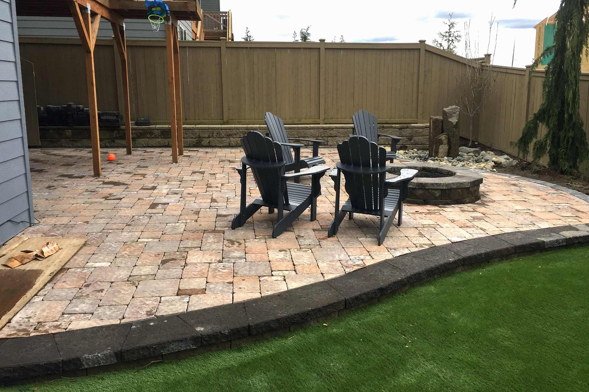 Raised paver patio and low-maintenance turf