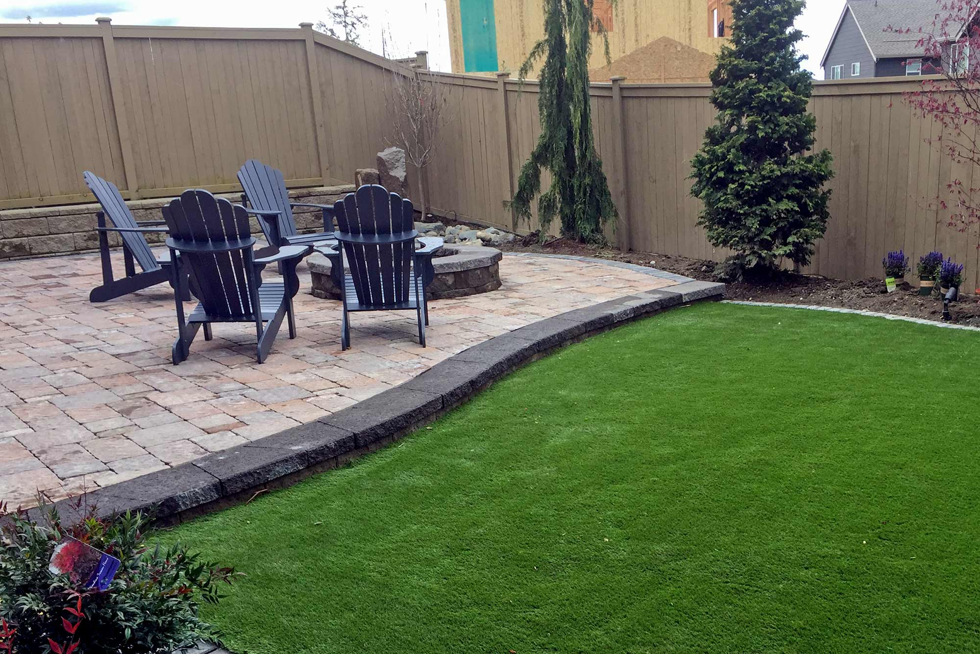 raised paver patio and artificial turf