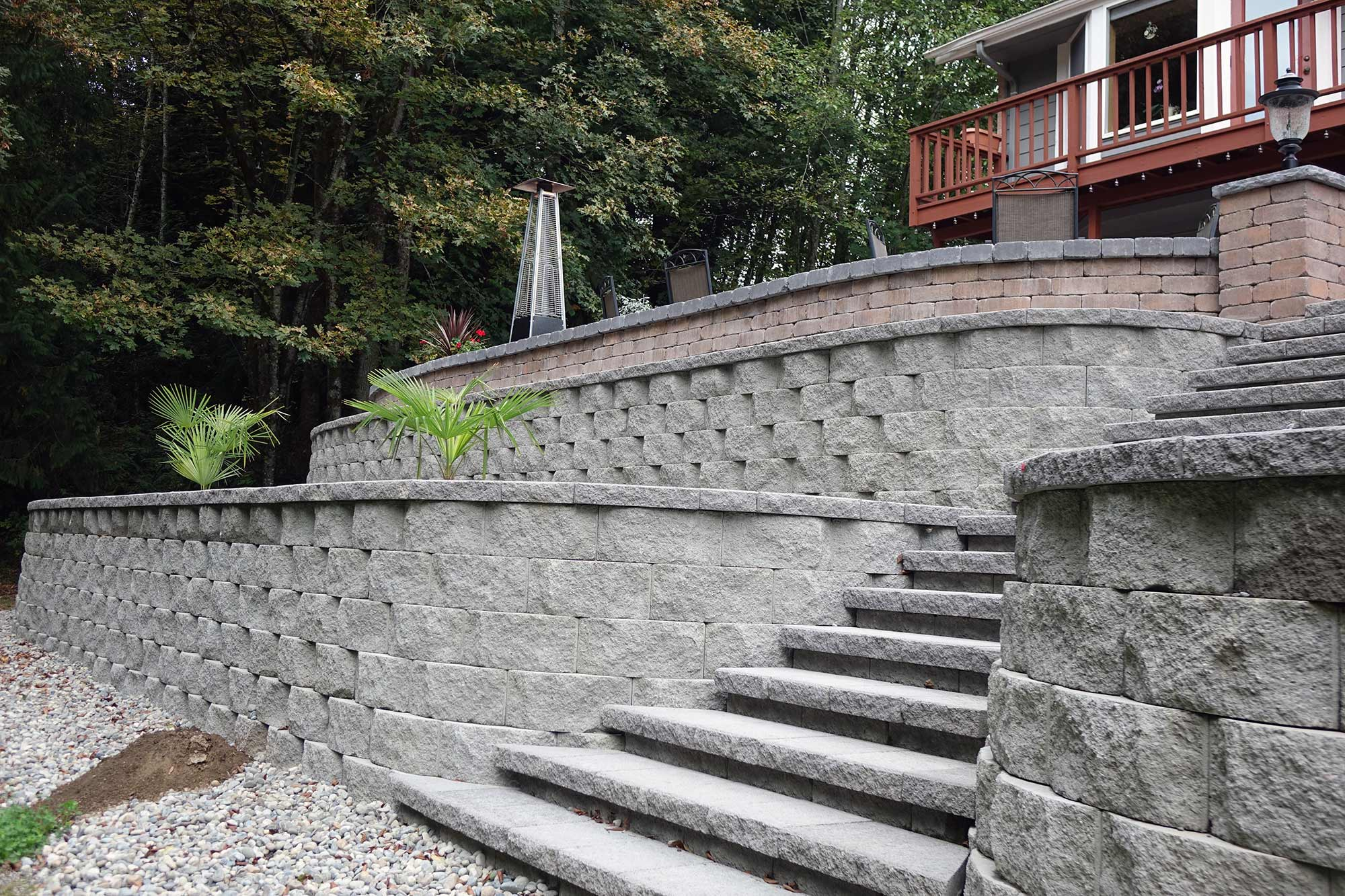 Three-tier retaining wall with staircase