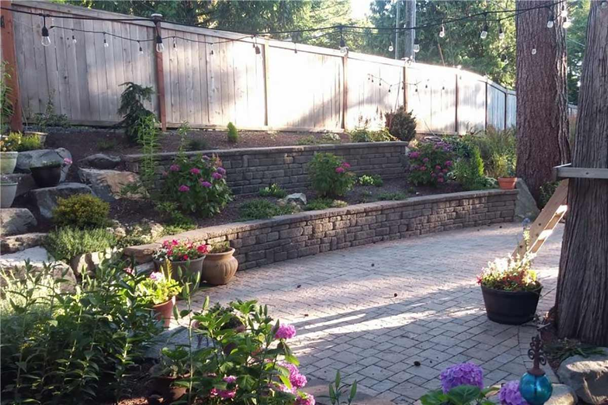 Celtik retaining wall, Dominion Slate paver patio and rockery