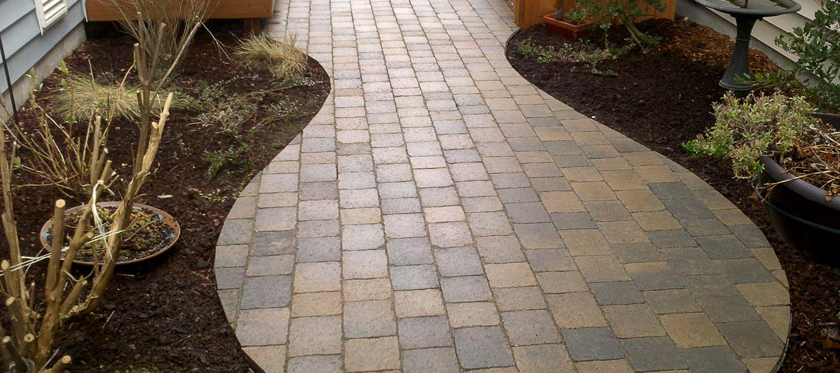 Small paver path with rounded patio.
